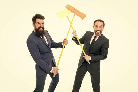 Partnership and teamwork. clean slate. Partnership of businessmen clear wall to white. cleaning company. clean business. mature bearded men in formal suit hold householding mop. successful teamwork