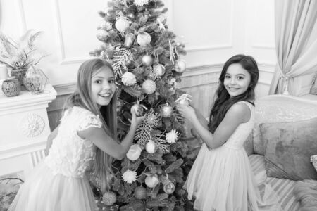 delivery christmas gifts. happy new year. happy little girls sisters celebrate winter holiday. christmas time. decorate christmas tree. Cute little children girl with xmas present. Family holiday