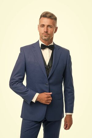 Tailored suit. Menswear concept. Guy well groomed handsome macho wear black tuxedo. Groom fashion trend. Fashion clothes. Modern trend. Rent suit service. Elegant outfit. Gentleman fashion style Stock fotó