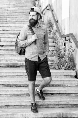 I love New York. Mature hipster with beard traveller. Bearded man. Confident brutal man walk street. Male barber care. brutal hipster with travel backpack. hiking adventure concept. urban style