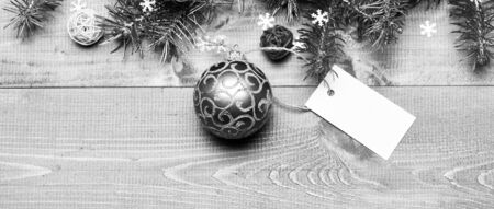 Christmas decorations wooden background top view. Tips for preparing christmas in advance. Decorative ball toy and gift tag copy space. Winter and christmas holidays concept. Get ready for christmas. Stock fotó