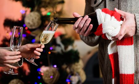 Merry christmas. Almost midnight. Alcohol drink. Having nice time. Toast. Glass of champagne. Champagne couple glasses. Glass filled sparkling wine or champagne. Cheers concept. New year tradition.