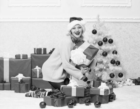 Give her gift that she always wanted. Woman excited blonde hold gift box with bow. Perfect gift for girlfriend or wife. Opening christmas gift. Girl near christmas tree happy celebrate holiday Stock Photo