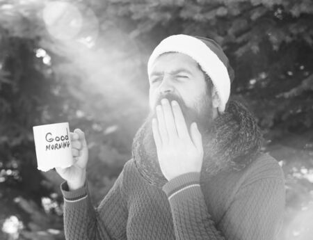 yawning man in santa hat