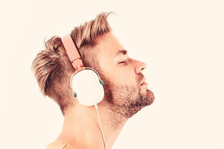 Man listening music headphones white background. Modern technology. Music taste concept. Enjoy perfect music sound headphones. Buy music gadget. Shop store musical accessory gadgets. Sale discount