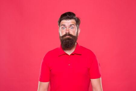 Hairstyle is kind of art. Well groomed hipster. Barbershop concept. Facial hair care. Hiring barber. Barber career. Barber salon. Man bearded hipster with long beard and mustache on red background 스톡 콘텐츠