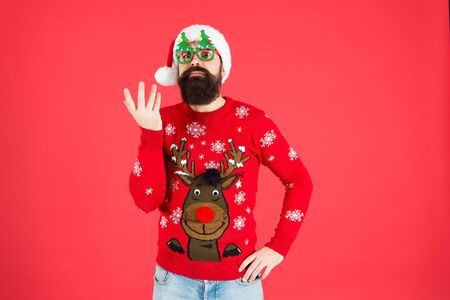 Ho Ho Ho. winter holiday. cold season clothes. happy new year. bearded santa man party glasses. serious santa ready to celebrate xmas. its time for christmas. man reindeer on knitted sweater Stock fotó
