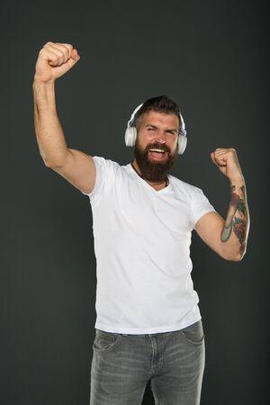 Dj career. Sound producer. Application for listening. Lifestyle music fan. Man listening music wireless headphones. Hipster headphones gadget. Inspiring song. Music library. Bearded guy enjoy music