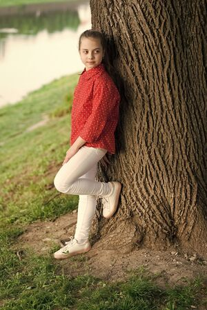 Find peace and relax in nature. Calm and peaceful. Life balance. Peaceful mood. Good vibes only. Girl little cute child enjoy peace and tranquility at tree trunk. Place of power. Peaceful place