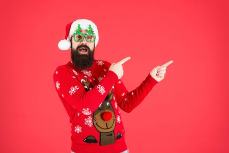 Time to celebrate. santa man party glasses. cheerful santa ready to celebrate xmas. time for christmas. hipster man reindeer on sweater. winter holiday. christmas shopping. happy new year. look here Stock fotó