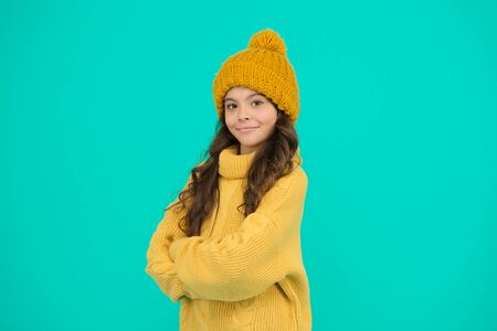 Stay warm. Small child wear hat and sweater. Climate control. Cold weather. Thermal protection concept. Thermal insulation. Thermal garment shop. Cute girl enjoy winter. Little kid wear knitted hat