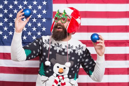 God bless America. Patriotic santa celebrate winter holidays. Christmas bulbs with american flag. National holidays. Happy holidays. Celebrate the holidays and your patriotism