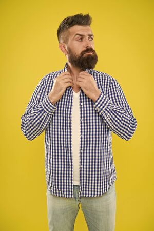Mature man expressing interest. Summer hipster grooming. Male fashion and spring style. Brutal bearded hipster in checkered shirt. surprised man with beard on yellow background. morning grooming Banco de Imagens