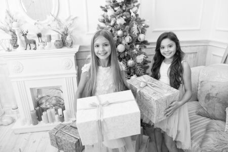 children girl with xmas present. happy little girls sisters celebrate winter holiday. christmas time. happy new year. Decorate your Christmas with joy. delivery christmas gifts. Family holiday