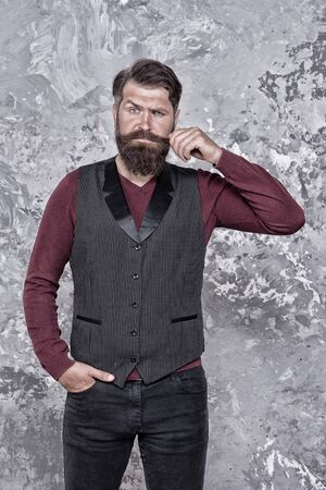 Barbershop concept. Beauty industry. Facial hair care. Mature man bearded hipster with long beard and mustache. Styling mustache. Growing long mustache. Moustache style. Well groomed hipster