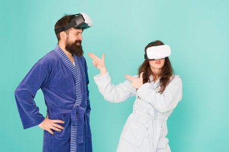 create your reality. world of immagination. family couple wear vr glasses. girl and man hipster relax in bathrobe. morning start with future technology. digital couple. innovation in family relations Banco de Imagens