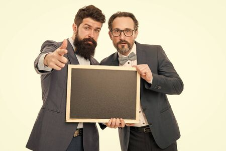 announcement. party invitation. partners celebrate start up business on white. businessmen use phone, copy space. bearded men hold advertisement blackboard. welcome on board. invitation concept Banque d'images