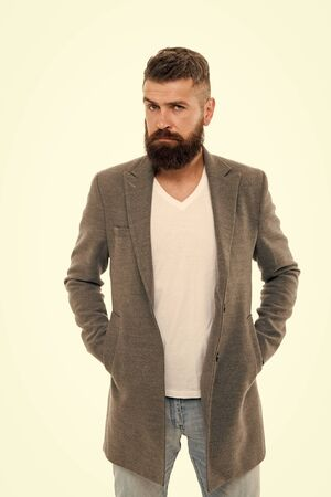 Owner of brutal beard. Caucasian man with brutal appearance. Bearded man with moustache and beard on unshaven face in brutal style. Brutal hipster wearing casual outfit 写真素材