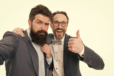 Sealing a deal. collaboration and teamwork. partnership of boss men isolated on white. mature men have own business. bearded businessmen in formal suit. business meeting. team success. High-five