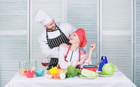 Couple compete in culinary arts. Reasons why couples cooking together. Cooking with your spouse can strengthen relationships. Woman and bearded man culinary partners. Ultimate cooking challenge