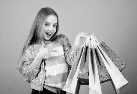 mega sale. Small girl with shopping bags. special offer. Holiday purchase saving. Kid fashion. shop assistant with package. Sales and discounts. Happy child. Little girl with gifts. It is bargain Stock fotó