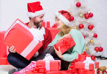 Loving woman and bearded man wear santa claus hat christmas tree background. Christmas eve with darling. Love is best gift. Begin new year together. Couple in love enjoy christmas holiday celebration Stock Photo
