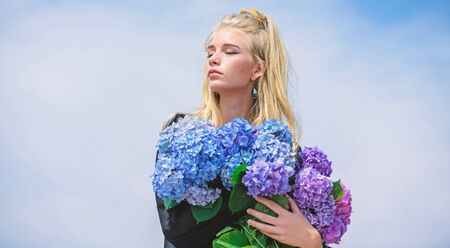 Makeup and fashion style. Fashion trend spring. Meet spring with new perfume fragrance. Flowers tender fragrance. Fashion and beauty industry. Girl tender fashion model hold hydrangea flowers bouquet