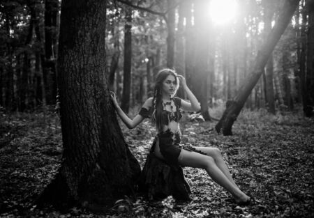 Female spirit mythology. Wilderness of virgin woods. She belongs tribe warrior women. Wild attractive woman in forest. Folklore character. Living wild life untouched nature. Sexy girl. Wild human
