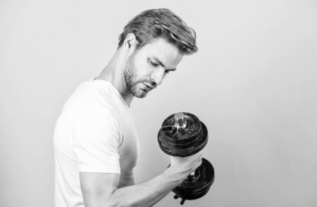 perfect biceps. sportsman training in gym. Sport dumbbell equipment. Athletic fitness man. Weight lifting. man workout with barbell. power and energy. Strong muscles and power. man lifting barbell