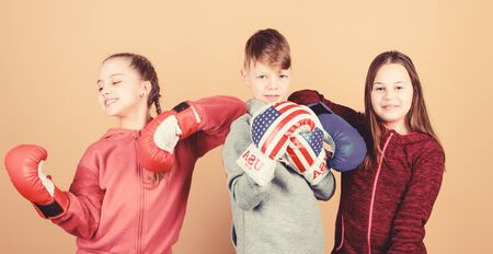 Team fight. Sport success. workout of small girls and boy boxer in sportswear. Happy children in boxing gloves. Fitness diet. energy health. punching knockout. Childhood. Relaxing after training