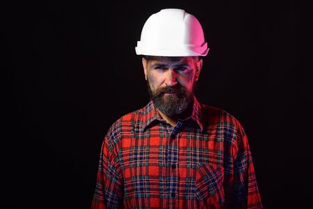 Labour and heavy industry concept. Builder or repairer with beard