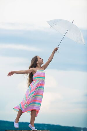 day dreamer. Everyday winner. small girl with umbrella. autumn weather forecast. rainy weather. Fall mood. carefree childhood. autumn fashion. Freedom and happiness