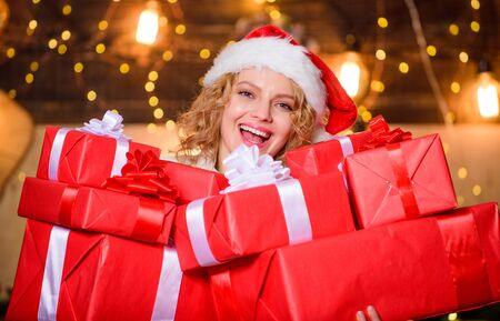Gift shop. Holiday hustle and bustle. Preparing surprise. Tips how to save money on christmas shopping. Happy woman hold gift boxes. Give and receive. Pick perfect gift. Peace and joy sold here Banque d'images