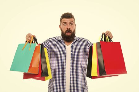brutal surprised caucasian hipster with moustache. Mature hipster with beard. Bearded man with shopping bags.. Shopping sale. Male barber care. Black Friday. Cyber Monday. Own business