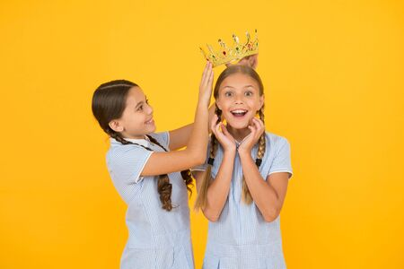 She is the best. Happy schoolgirls and golden crown symbol of success. Success and respect. Little princess. Motivational award for school children. Succeed in education. Celebrating success