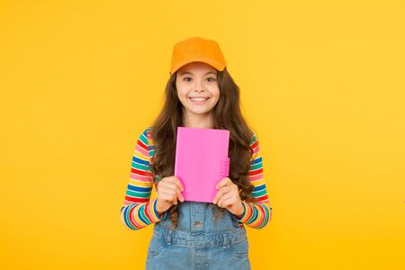 Education outside of structured curriculum. Informal education concept. Child happy smiling girl with notepad book enjoy studying non formal atmosphere. Join school literature club. Education is fun