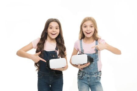 Cyber gaming. Virtual reality is exciting. Girls little kids wear vr glasses white background. Virtual education concept. Modern life. Interaction in virtual space. Augmented reality technology