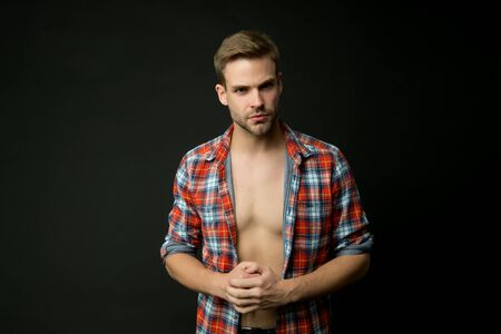 Masculine traits concept. Male fashion and beauty. Sexy muscular macho. Athlete man undressing. Muscular guy. Man confident face taking off shirt. Full of desire. Perfect body. Muscular chest