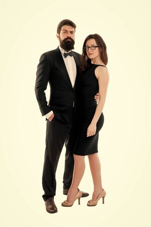 Woman elegant lady and bearded gentleman black tuxedo with bow tie. Formal event. Dress code rules. Party ceremony conference. Dress code concept. Couple get ready for party. Official dress code