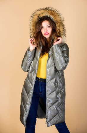 Shopping in any weather. flu and cold. seasonal fashion. woman in padded warm coat. beauty in winter clothing. cold season shopping. happy winter holidays. girl in puffed coat. faux fur fashion