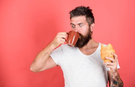 favorite breakfast. Bearded hipster enjoy breakfast drink coffee. Morning tradition concept. Fresh baked croissant. Delicious breakfast. Unhealthy but yummy breakfast. Perfect match. feel hunger