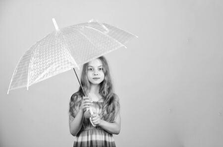 Weather forecast. Fall season. Enjoy rain concept. Waterproof accessory. Rainy days coming. Love rainy days. Kid girl happy hold transparent umbrella. Enjoy rainy weather. Invisible protection Standard-Bild