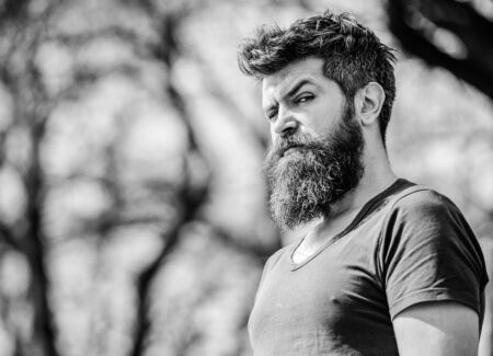bearded man with lush hair. Free and happy time. male fashion and beauty. brutal male with perfect style. Mature hipster with beard. Bearded man outdoor. Beard care. Just me and no one else