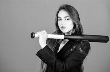 I will find you wherever you are. confident businesswoman. successful girl on blue background. Street life. criminal dirty business. Sporty girl fighter. Sport equipment. sexy woman with baseball bat