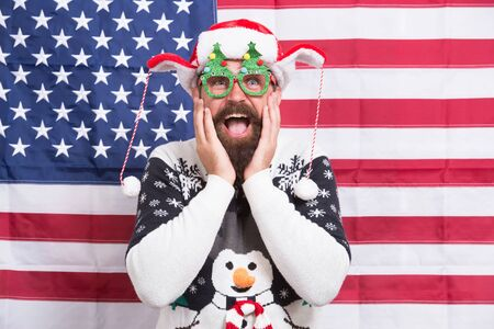 I am so happy. Christmas in usa. Live your dreams. Santa at american flag. Bearded american man celebrate new year. National us flag. Patriotic spirit. American man celebrate winter holiday