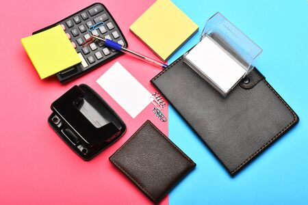 Calculator, notebook, hole punch, business card holder and note paper Stock Photo