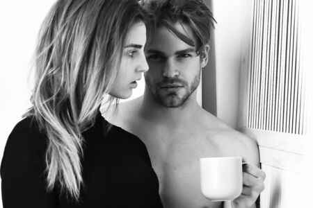 couple of bearded man with cute sexy girl holding cup Zdjęcie Seryjne