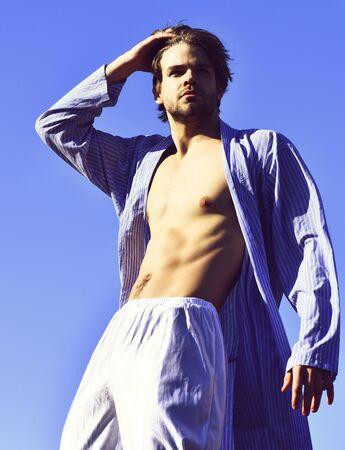 Caucasian macho in blue striped pajamas 版權商用圖片