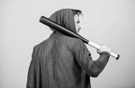 Taking a break. Hooligan macho hits the bat. sport activity. full of energy. Sport. Bandit gang and conflict. aggression and anger. man with baseball bat. Sexy muscular man fighting Stock Photo