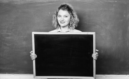 Outstanding education. informations board. announcement concept. place to write task. happy student girl hold blank board. woman teacher at blackboard. copy space. here is your advertisement Reklamní fotografie
